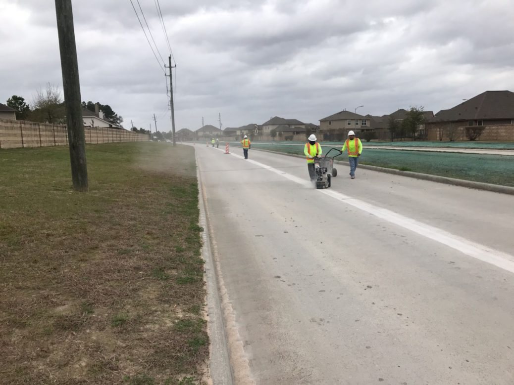 Striping the lanes on Elan Boulevard | Precinct 3 Commissioner James Noack